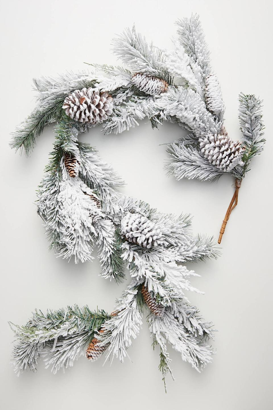 """<p>Bring the brisk outdoor air into your interior with the <a href=""""https://www.popsugar.com/buy/Snowy-Pinecone-Garland-490557?p_name=Snowy%20Pinecone%20Garland&retailer=anthropologie.com&pid=490557&price=78&evar1=casa%3Aus&evar9=46615300&evar98=https%3A%2F%2Fwww.popsugar.com%2Fhome%2Fphoto-gallery%2F46615300%2Fimage%2F46615428%2FSnowy-Pinecone-Garland&list1=shopping%2Canthropologie%2Choliday%2Cchristmas%2Cchristmas%20decorations%2Choliday%20decor%2Chome%20shopping&prop13=mobile&pdata=1"""" rel=""""nofollow noopener"""" class=""""link rapid-noclick-resp"""" target=""""_blank"""" data-ylk=""""slk:Snowy Pinecone Garland"""">Snowy Pinecone Garland</a> ($78).</p>"""