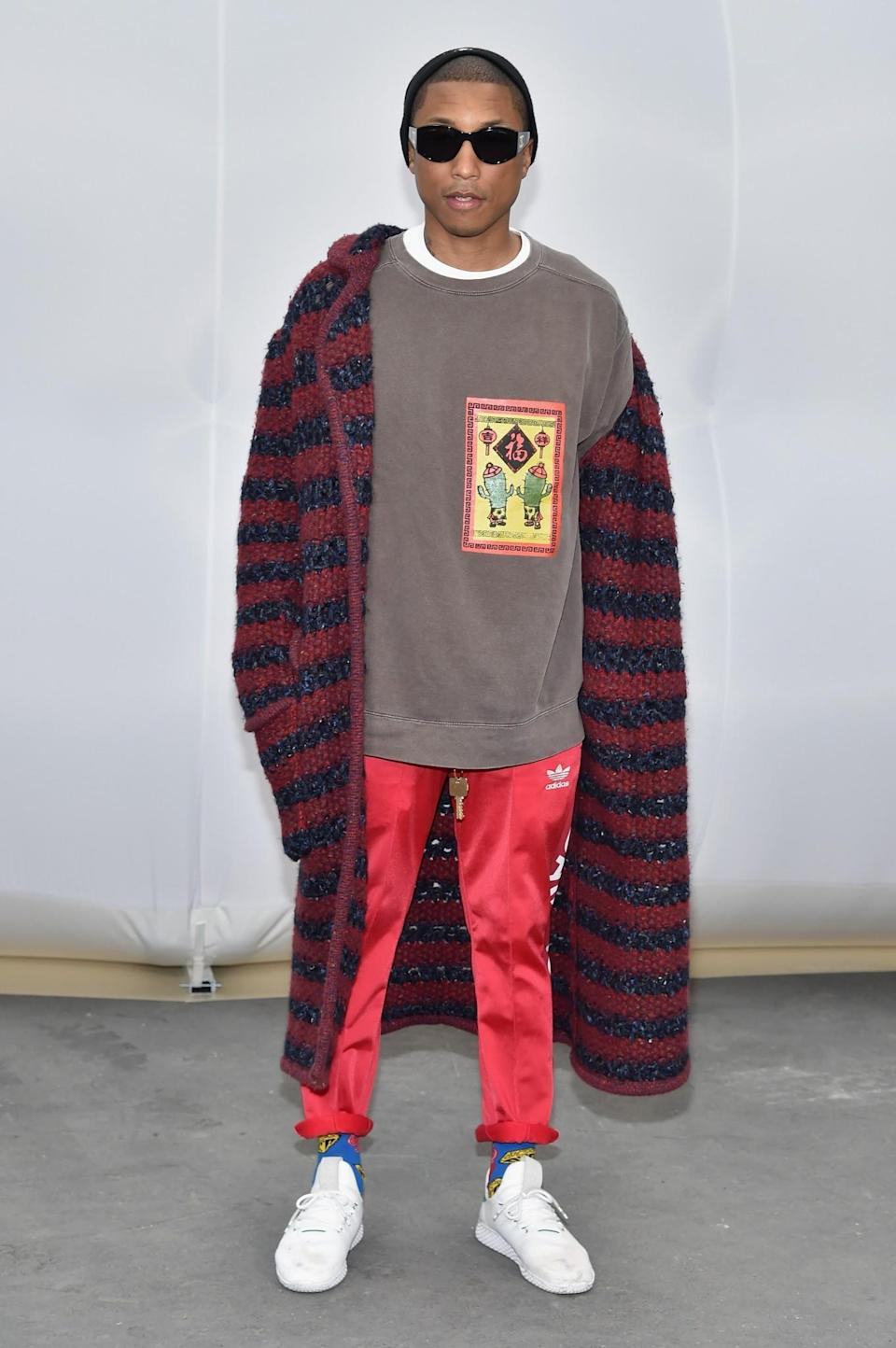 <p>Pharrell donned a mish-mash of high-end and sportswear. <i>[Photo: Getty]</i> </p>