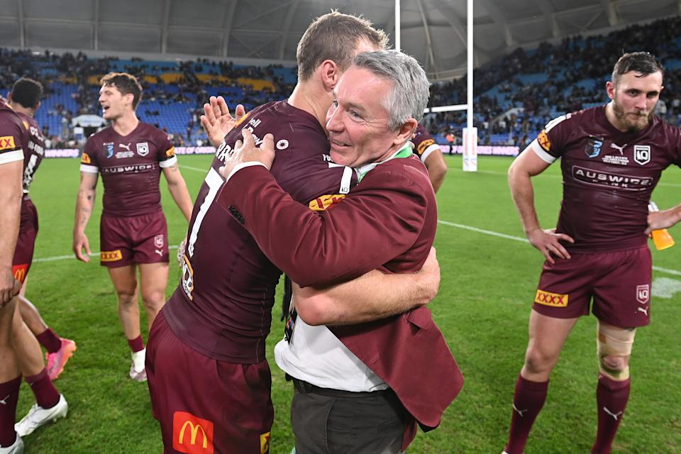 Seen here, Maroons captain Daly Cherry-Evans and coach Paul Green hug after Origin Game III.