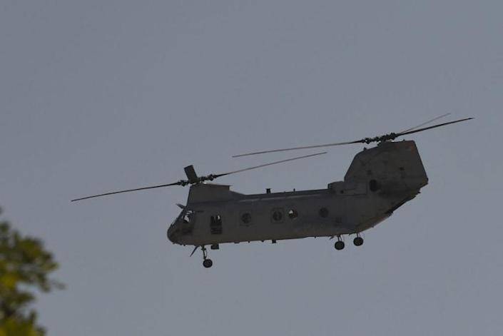 A US military helicopter is pictured flying near the US embassy in Kabul.
