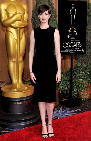 <b>Anne Hathaway </b><br><br>The Les Miserables actress opted for a simple The Row LBD and strappy black pumps.<br><br>© Rex