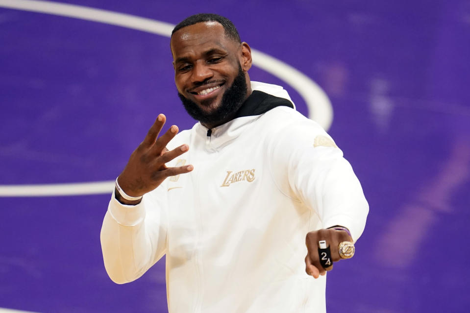 FILE - In this Tuesday, Dec. 22, 2020, file photo, Los Angeles Lakers forward LeBron James reacts after receiving his NBA championship ring before an NBA basketball game against the Los Angeles Clippers in Los Angeles. James was announced Saturday, Dec. 26, as the winner of The Associated Press' Male Athlete of the Year award for a record-tying fourth time. (AP Photo/Marcio Jose Sanchez, File)