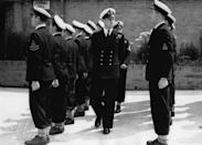 <p>A stern-looking Philip was in military mode while inspecting his troops in July 1947. Photo: Getty Images.</p>