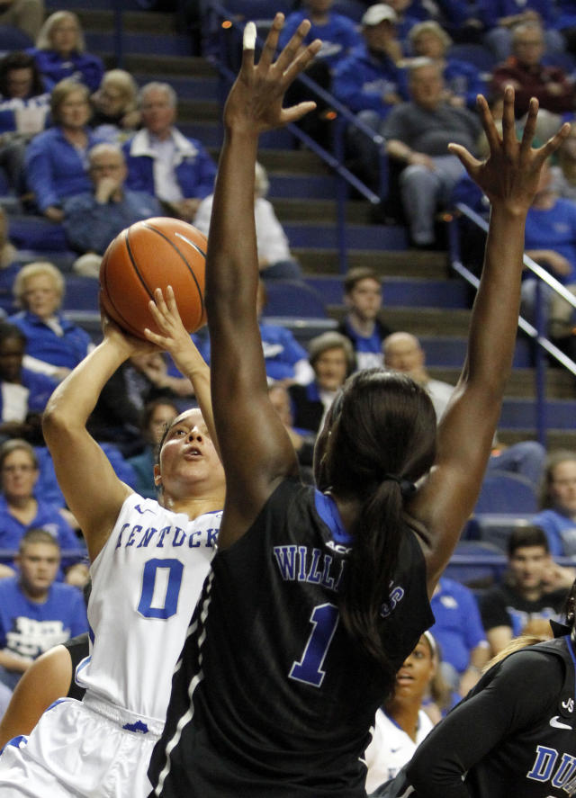 Kentucky's Jennifer O'Neill (0) shoots under pressure from Duke's Elizabeth Williams (1) during the first half of an NCAA college basketball game, Sunday, Dec. 22, 2013, in Lexington, Ky. (AP Photo/James Crisp)