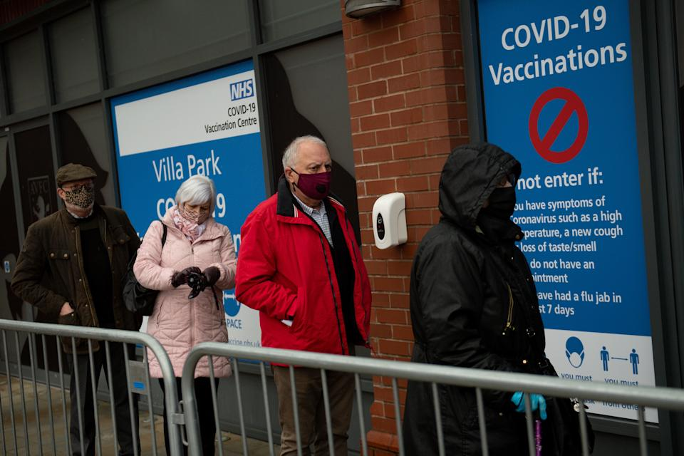 BIRMINGHAM, ENGLAND - FEBRUARY 04: Members of the public arrive at the new seven day vaccination centre at Villa Park on February 04, 2021 in Birmingham, England. The Villa Park vaccination centre, home of Aston Villa football club, is expected to deliver approximately 1,500 doses to the public everyday. (Photo by Jacob King - Pool/Getty Images)