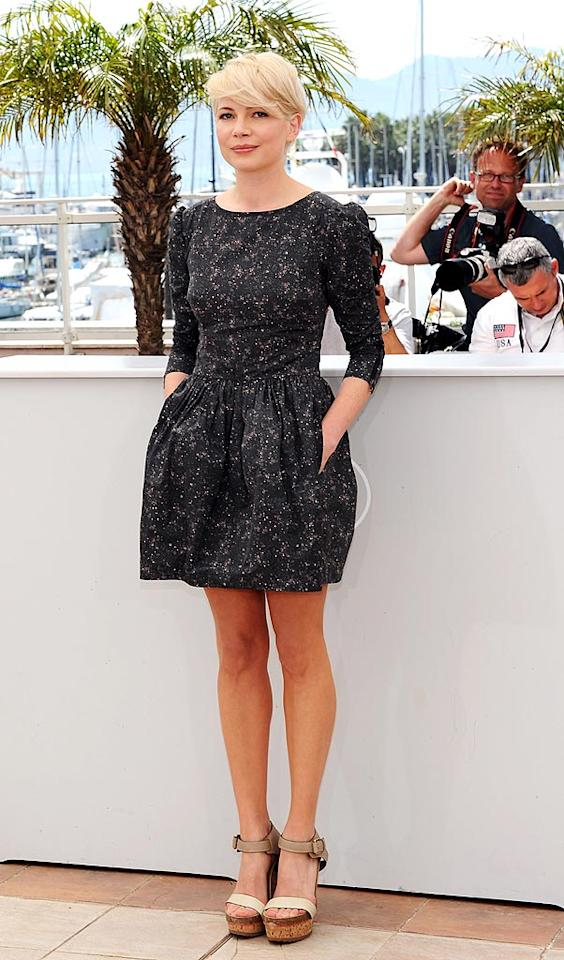 """Michelle Williams made a mark at the Cannes Film Festival. The diminutive star of the upcoming romantic drama, """"Blue Valentine,"""" attended a photo call for the flick in a super-cute, pocketed Suno frock, strappy Stella McCartney cork wedges, and a short-n-sunny hairstyle. Michael Buckner/<a href=""""http://www.gettyimages.com/"""" target=""""new"""">GettyImages.com</a> - May 18, 2010"""