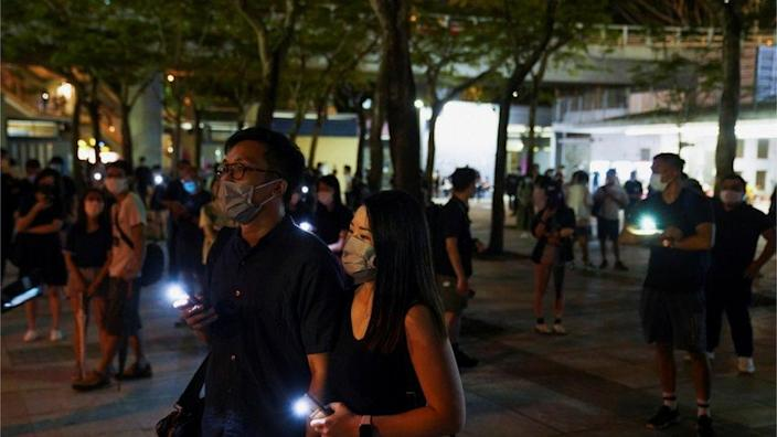 People gathering near Victoria Park in June 2021 with telephone lights on