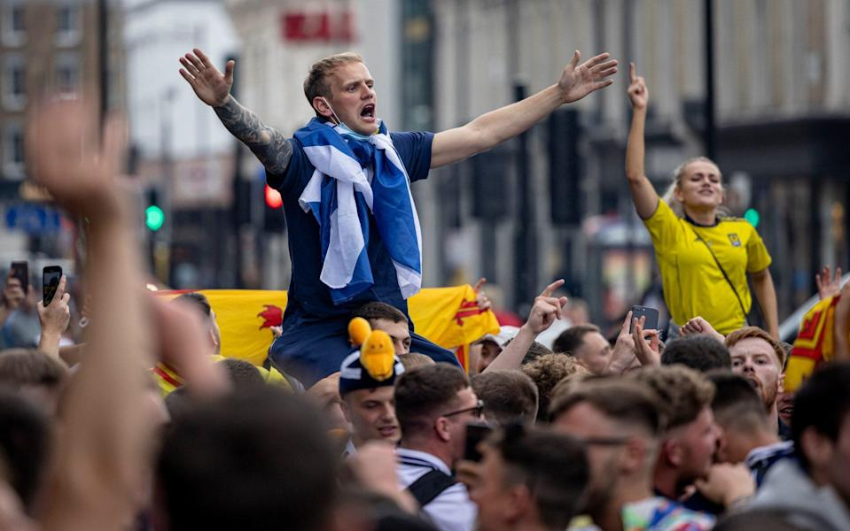 Scotland fans in full voice outside King's Cross station - GETTY IMAGES