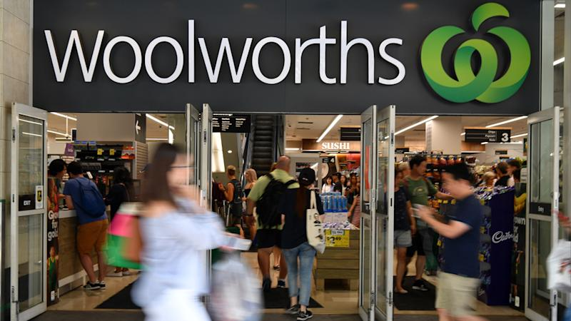 Pictured are shoppers outside a Woolworths supermarket.