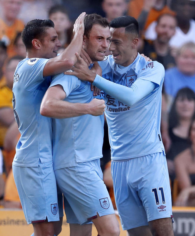 Burnley's Ashley Barnes, center, celebrates scoring against Wolverhampton Wanderers during the English Premier League soccer match Between Burnley and Wolverhampton Wanderers at Molineux, Wolverhampton, England, Sunday Aug. 25, 2019. (Darren Staples/PA via AP)
