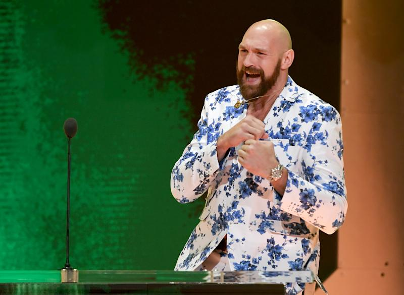 LAS VEGAS, NEVADA - OCTOBER 11: Heavyweight boxer Tyson Fury shadowboxes as he speaks at a WWE news conference at T-Mobile Arena on October 11, 2019 in Las Vegas, Nevada. Fury will face WWE wrestler Braun Strowman and WWE champion Brock Lesnar will take on former UFC heavyweight champion Cain Velasquez at the WWE's Crown Jewel event at Fahd International Stadium in Riyadh, Saudi Arabia on October 31. (Photo by Ethan Miller/Getty Images)