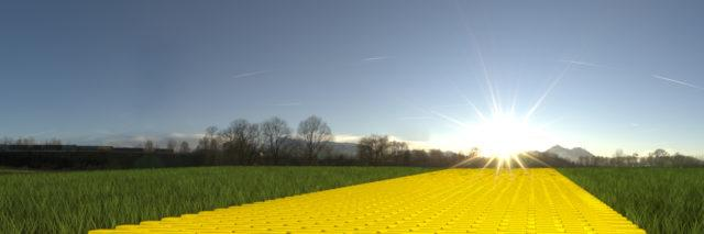 Yellow brick road on grass with sun and blue sky