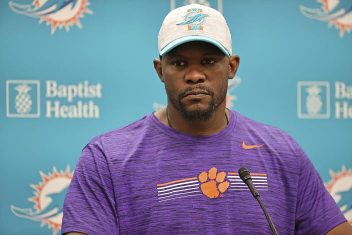 Miami Dolphins NFL football team head coach Brian Flores talks to the media before practice in Miami Gardens Fla., Wednesday, Oct. 13, 2021. The Dolphins play against the Jacksonville Jaguars in London on Sunday. (David Santiago/Miami Herald via AP)