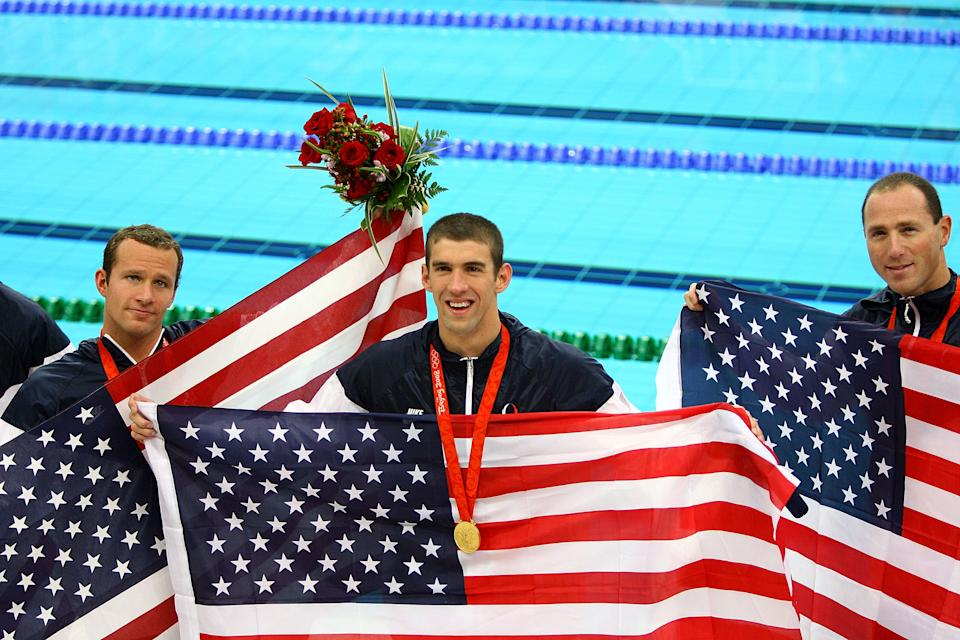 <b>Medal No. 16</b><br>Michael Phelps stands between teammates Brendan Hansen and Jason Lezak after winning the gold medal in the Men's 4x100 Medley Relay in Beijing. The United States team set a new world record with a time of 3:29:34.