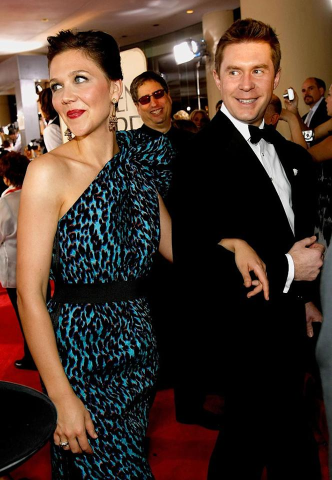 "Hey, that's not Peter Sarsgaard! Maggie Gyllenhaal was escorted by a mystery man. Michael Buckner/<a href=""http://www.gettyimages.com/"" target=""new"">GettyImages.com</a> - January 11, 2009"