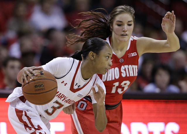 Maryland guard Brene Moseley, left, drives the ball around Ohio State guard Cait Craft in the first half of an NCAA college basketball game in College Park, Md., Wednesday, Dec. 4, 2013. (AP Photo/Patrick Semansky)