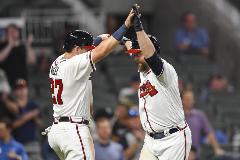 Jun 17, 2019; Atlanta, GA, USA; Atlanta Braves catcher Brian McCann (right) and Austin Riley (27) celebrate after both scored on a home run by McCann against the New York Mets during the eighth ninth inning at SunTrust Park. Mandatory Credit: Dale Zanine-USA TODAY Sports