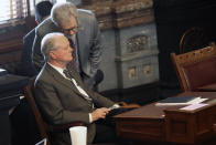 Kansas Senate Majority Leader Gene Suelletrop, left, R-Wichita, confers with his chief of staff, Eric Rucker, right, during a Senate session, Friday, April 9, 2021, at the Statehouse in Topeka, Kan. Suellentrop is facing a call to resign after being charged with drunken driving and trying to elude law enforcement over his March 16, 2021, arrest in Topeka. (AP Photo/John Hanna)