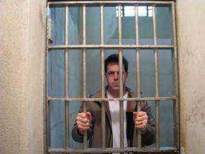 Guy behind bars