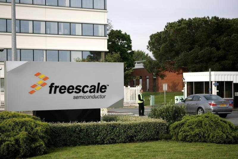 A car enters the Freescale Semiconductor Inc plant in Toulouse