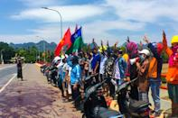 In Karen state, activists poured red paint on the road and made the three-fingered salute, a symbol of the protests