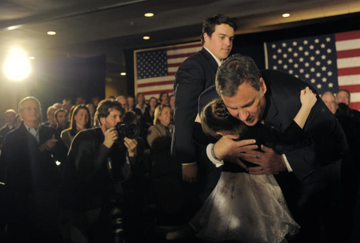 <p>New Jersey Gov. Chris Christie hugs Sienna Szarek, 7, after addressing the crowd at his primary election-night party in Nashua, N.H., on Feb. 9, 2016. (Gretchen Ertl/Reuters)</p>