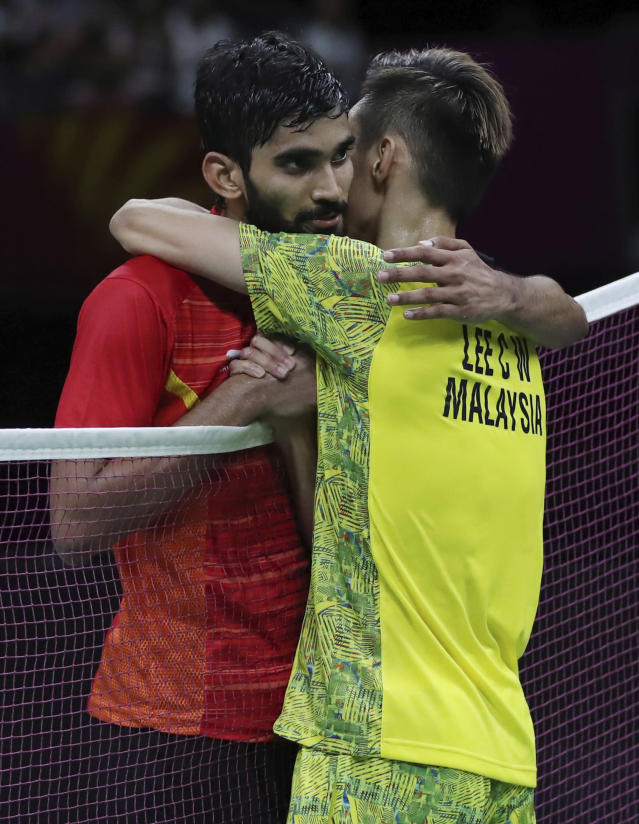 Malaysia's Lee Chong Wei hugs India's Srikanth Kidambi after their men's singles badminton final match at Carrara Sports Hall during the Commonwealth Games on the Gold Coast, Australia, Sunday, April 15, 2018. Lee won the match. (AP Photo/Dita Alangkara)