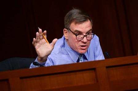 Warner speaks during Facebook digital currency hearing