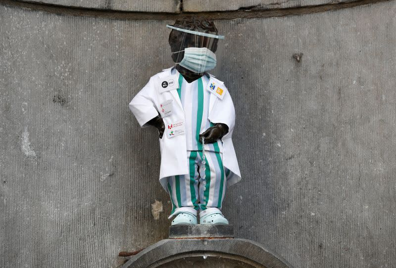 Brussels honours health workers by dressing up famous statue