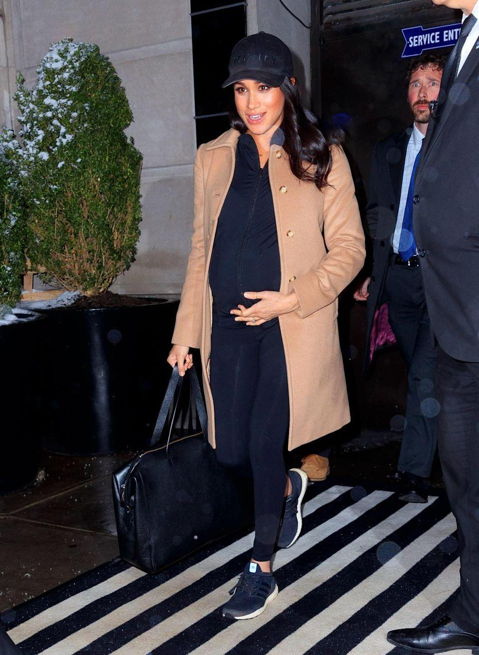 """<p>Meghan Markle wore a camel coat over her black atheleisure outfit that she paired with a black baseball cap, sneakers, and a leather <a href=""""https://go.redirectingat.com?id=74968X1596630&url=https%3A%2F%2Fwww.cuyana.com%2Fle-sud-leather-weekender.html&sref=https%3A%2F%2Fwww.townandcountrymag.com%2Fstyle%2Ffashion-trends%2Fg3272%2Fmeghan-markle-preppy-style%2F"""" rel=""""nofollow noopener"""" target=""""_blank"""" data-ylk=""""slk:weekender by Cuyana"""" class=""""link rapid-noclick-resp"""">weekender by Cuyana</a>, as she left the Mark Hotel for the airport. The Duchess has been in New York for the past five days to <a href=""""https://www.townandcountrymag.com/society/tradition/a26409579/meghan-markle-baby-shower-details/"""" rel=""""nofollow noopener"""" target=""""_blank"""" data-ylk=""""slk:celebrate her baby shower"""" class=""""link rapid-noclick-resp"""">celebrate her baby shower</a> with close friends. </p><p><a class=""""link rapid-noclick-resp"""" href=""""https://go.redirectingat.com?id=74968X1596630&url=https%3A%2F%2Fwww.cuyana.com%2Fle-sud-leather-weekender.html&sref=https%3A%2F%2Fwww.townandcountrymag.com%2Fstyle%2Ffashion-trends%2Fg3272%2Fmeghan-markle-preppy-style%2F"""" rel=""""nofollow noopener"""" target=""""_blank"""" data-ylk=""""slk:SHOP NOW"""">SHOP NOW</a> <em>Cuyana Weekender Bag, $395</em></p>"""