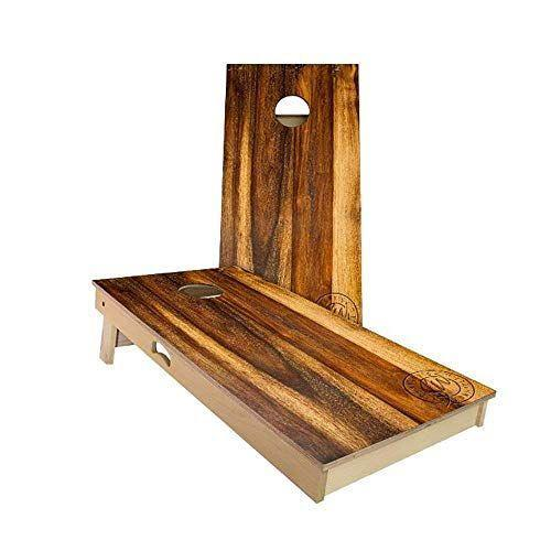 """<p><strong>Slick Woody's Cornhole Co.</strong></p><p>amazon.com</p><p><strong>$250.00</strong></p><p><a href=""""https://www.amazon.com/dp/B06XCTTML7?tag=syn-yahoo-20&ascsubtag=%5Bartid%7C10060.g.37213118%5Bsrc%7Cyahoo-us"""" rel=""""nofollow noopener"""" target=""""_blank"""" data-ylk=""""slk:Shop Now"""" class=""""link rapid-noclick-resp"""">Shop Now</a></p><p>This set, made in the USA, is a fan favorite, with 90% 5-star ratings. Slick Woody's finishes their solid-wood boards with a unique, laminated vinyl surface that plays the same no matter what conditions you're competing in. While they weigh just over 33 pounds per board, they do have handles to help with portability. A few users disliked the vinyl surface, preferring a painted-on clear coat instead.</p>"""