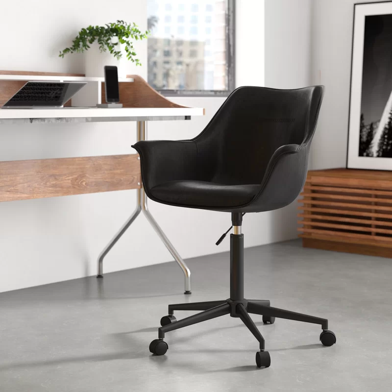 """<h3>Britt Task Chair</h3><br><strong>Best For: Understated Comfort</strong><br>This ergonomically designed chair is sleek and stylish while being comfortable and supportive. It features a thick cushioned seat, vegan leather, and a heavy-duty steel base. <br><br><strong>The Hype: </strong>4.6 out of 5 stars and 129 reviews on <a href=""""https://www.wayfair.com/furniture/pdp/wrought-studio-britt-task-chair-osbm1087.html"""" rel=""""nofollow noopener"""" target=""""_blank"""" data-ylk=""""slk:Wayfair"""" class=""""link rapid-noclick-resp"""">Wayfair</a><br><br><strong>Comfy Butts Say:</strong> """"Love this chair! Great color and perfect my office. I can sit it in for 5-7 hrs and still be comfortable. Love the modern design and the size of the seat base. Very easy to put together as well!""""<br><br><strong>Wrought Studio</strong> Britt Task Chair, $, available at <a href=""""https://go.skimresources.com/?id=30283X879131&url=https%3A%2F%2Fwww.wayfair.com%2Ffurniture%2Fpdp%2Fwrought-studio-britt-task-chair-osbm1087.html%3Fpiid%3D42741218"""" rel=""""nofollow noopener"""" target=""""_blank"""" data-ylk=""""slk:Wayfair"""" class=""""link rapid-noclick-resp"""">Wayfair</a>"""