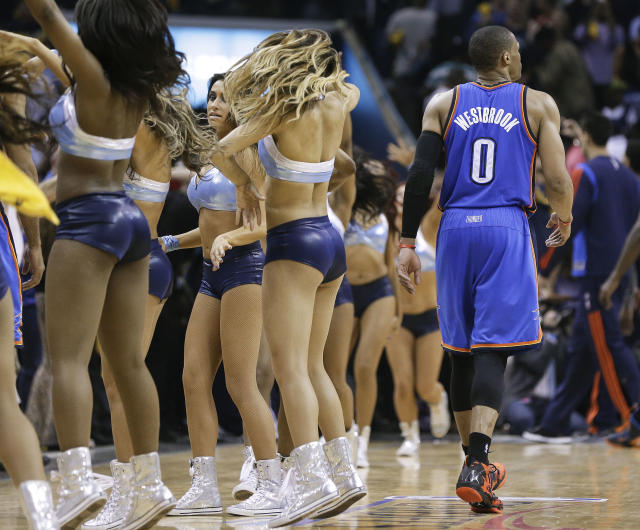 Oklahoma City Thunder guard Russell Westbrook (0) walks past Memphis Grizzlies dancers as he leaves the court after the Thunder's 98-95 loss to the Grizzlies in overtime in Game 3 of an opening-round NBA basketball playoff series Thursday, April 24, 2014, in Memphis, Tenn. (AP Photo/Mark Humphrey)