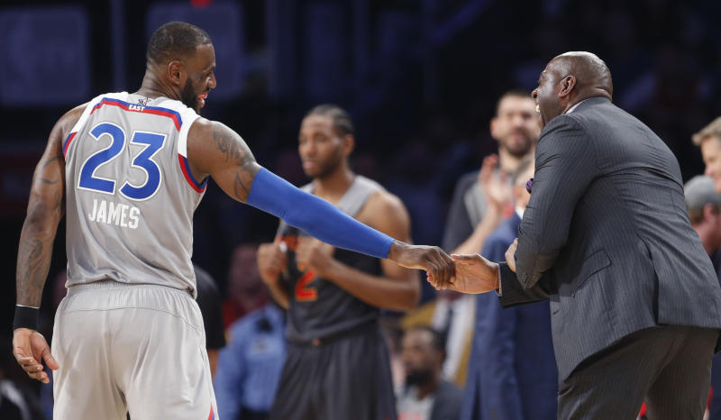 Former NBA player Magic Johnson reacts as he talks with Eastern Conference LeBron James of the Cleveland Cavaliers (23) during the first half of the NBA All-Star basketball game in New Orleans, Sunday, Feb. 19, 2017. (AP Photo/Gerald Herbert)