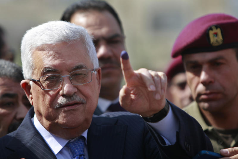 Palestinian President Mahmoud Abbas shows his ink-stained finger after casting his vote during local elections at a polling station in the West Bank city of Ramallah, Saturday, Oct. 20, 2012. Palestinians voted for mayors and local councils in 93 communities across the West Bank on Saturday, their first chance to cast ballots in six years. (AP Photo/Majdi Mohammed)