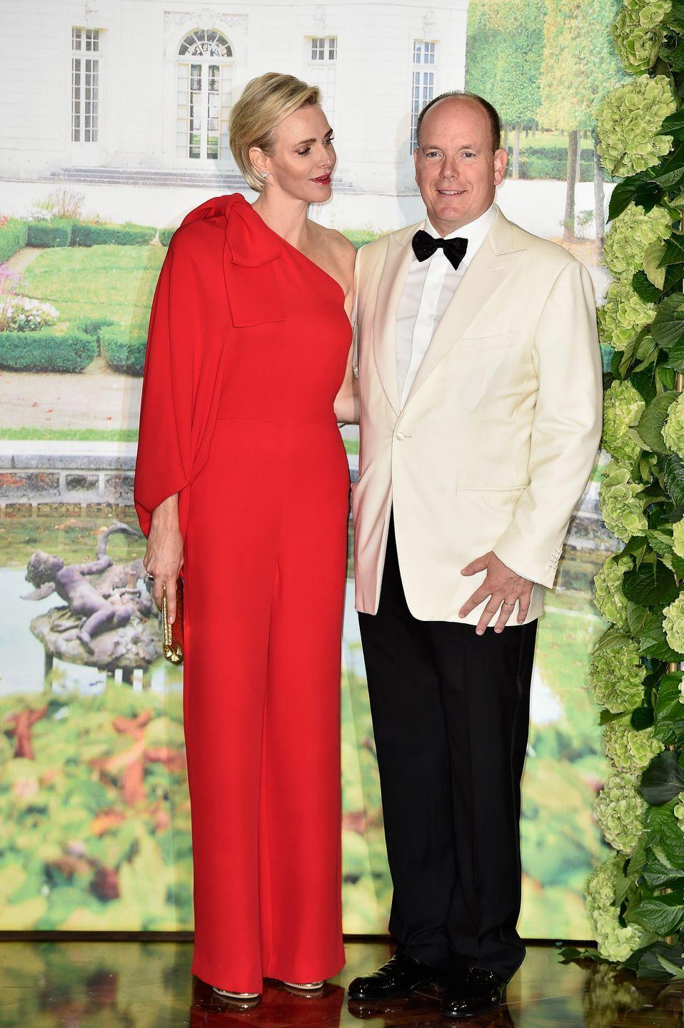 <p>She's pictured here at one of Monaco's largest events, the Red Cross Ball, in a one-shoulder red jumpsuit from Valentino.</p>