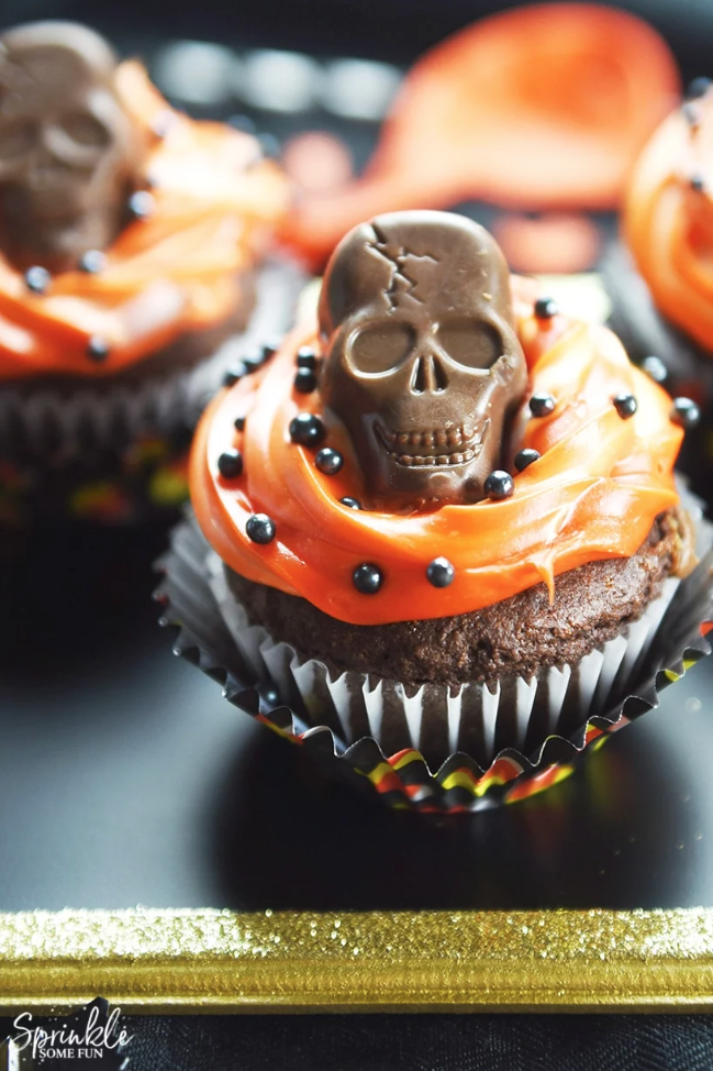 """<p>These cupcakes are stuffed <em>and </em>topped with Butterfinger candy for twice the fun and flavor.</p><p><strong>Get the recipe at <a href=""""https://sprinklesomefun.com/butterfinger-skull-cupcakes/"""" rel=""""nofollow noopener"""" target=""""_blank"""" data-ylk=""""slk:Sprinkle Some Fun"""" class=""""link rapid-noclick-resp"""">Sprinkle Some Fun</a>.</strong></p><p><a class=""""link rapid-noclick-resp"""" href=""""https://www.amazon.com/BUTTERFINGER-Peanut-Butter-Skulls-10-8/dp/B075X4DYLS/?tag=syn-yahoo-20&ascsubtag=%5Bartid%7C10050.g.1366%5Bsrc%7Cyahoo-us"""" rel=""""nofollow noopener"""" target=""""_blank"""" data-ylk=""""slk:SHOP BUTTERFINGER SKULLS"""">SHOP BUTTERFINGER SKULLS</a></p>"""