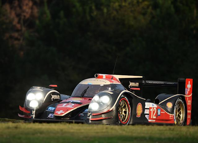 Nick Heidfeld, of Germany, drives his Rebellion Racing Lola B12/60 Toyota during the American Le Mans Series' Petit Le Mans auto race at Road Atlanta, Saturday, Oct. 19, 2013, in Braselton, Ga. (AP Photo/Rainier Ehrhardt)