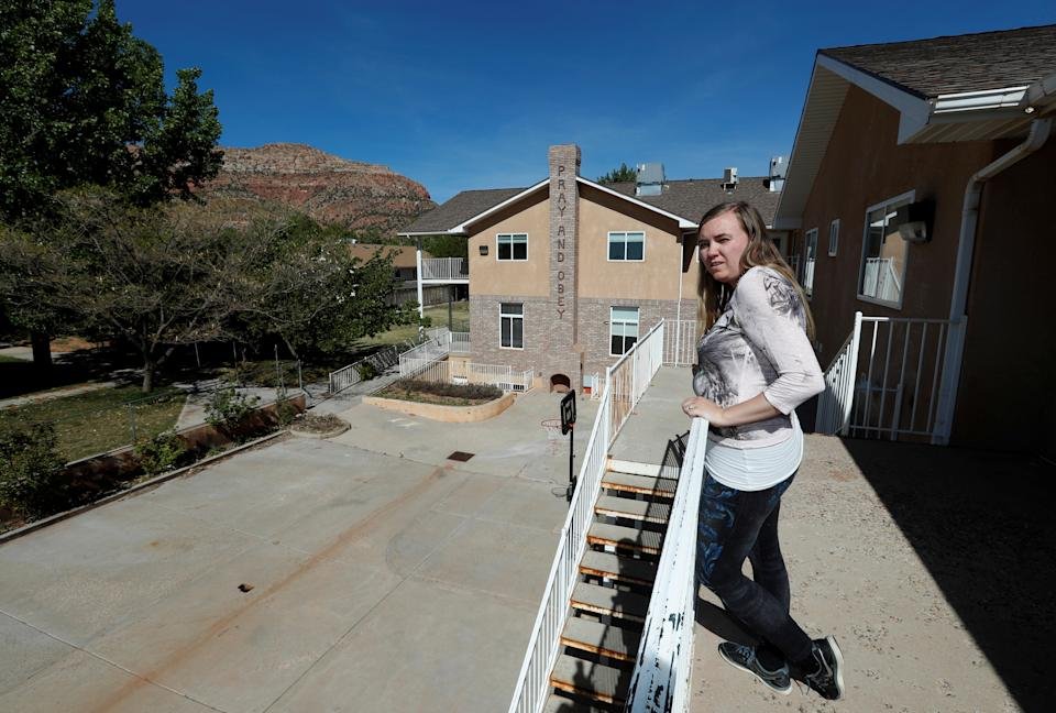 Briell Decker, the 65th wife of jailed Fundamentalist Church of Jesus Christ of Latter-Day Saints (FLDS Church) polygamist prophet leader Warren Jeffs, looks over a patio area at his compound, where he lived for several years, in Hildale, Utah, U.S., May 3, 2017. She is in the process of purchasing the compound. Picture taken May 3, 2017.  REUTERS/George Frey