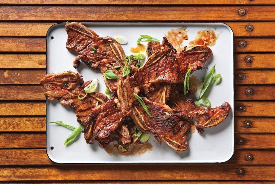 """Kalbi—marinated short ribs—are a classic at Korean barbecue restaurants, but they're eminently achievable at home. For dishes to serve them with, take a spin through some of our <a href=""""https://www.epicurious.com/recipes-menus/a-korean-extravaganza-gallery?mbid=synd_yahoo_rss"""" rel=""""nofollow noopener"""" target=""""_blank"""" data-ylk=""""slk:other Korean faves"""" class=""""link rapid-noclick-resp"""">other Korean faves</a>. <a href=""""https://www.epicurious.com/recipes/food/views/kalbi-366406?mbid=synd_yahoo_rss"""" rel=""""nofollow noopener"""" target=""""_blank"""" data-ylk=""""slk:See recipe."""" class=""""link rapid-noclick-resp"""">See recipe.</a>"""