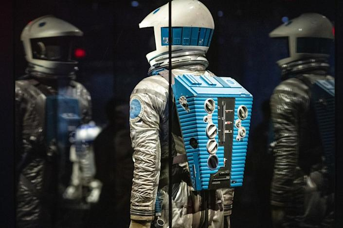 A space suit in a glass case in a museum