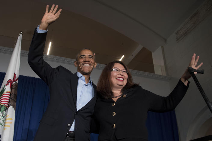 President Barack Obama waves to the crowd with Rep. Tammy Duckworth, D-Ill., during an event in Chicago on Oct. 9, 2016. (Photo: jim WatsonAFP/Getty Images)