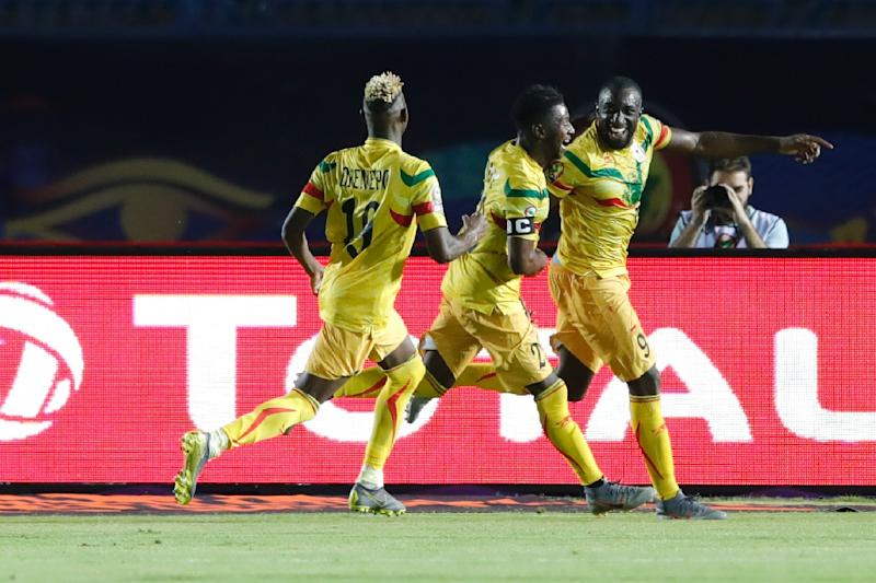 Moussa Marega (R) tucked away a penalty as Mali made a winning start
