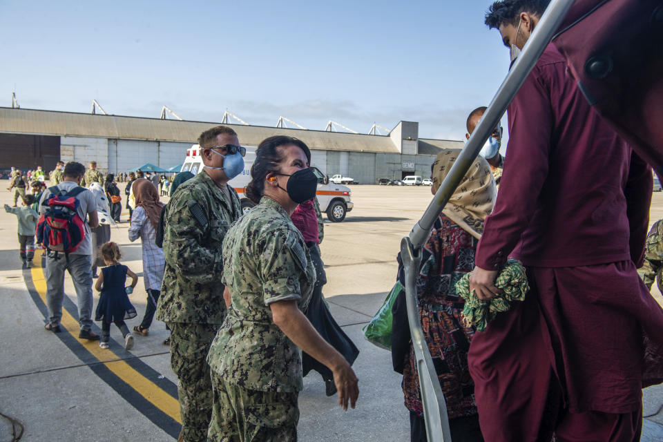 In this image provided by the U.S. Navy and taken on the military base in Rota, near Cadiz in southern Spain on Friday Aug. 27, 2021, evacuees from Afghanistan arrive at the Rota navy base. (U.S. Navy photo by Mass Communication Specialist 2nd Class John Owen, via AP)