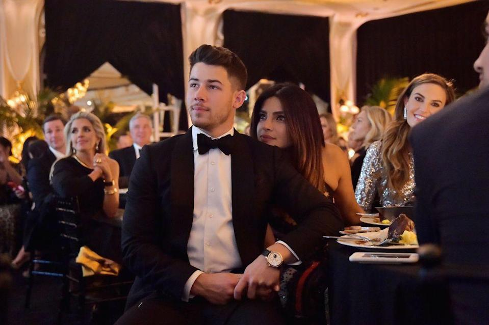 <p>Nick Jonas and Priyanka Chopra getting cosy while attending Learning Lab Ventures 2019 Gala Presented by Farfetch at Beverly Hills Hotel on January 31, 2019 </p>