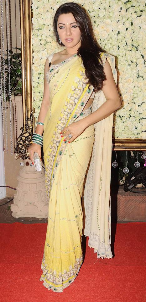 Kaykasshan Patel's light yellow sari and structured blouse are the way to go for a for a day wedding or reception we feel.