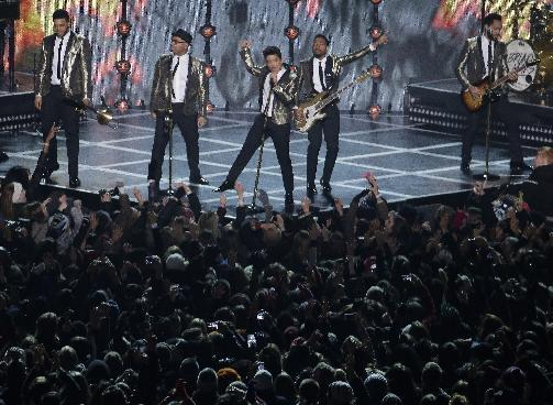Bruno Mars performs during the halftime show of the NFL Super Bowl XLVIII football game between the Seattle Seahawks and the Denver Broncos Sunday, Feb. 2, 2014, in East Rutherford, N.J. (AP Photo/Charlie Riedel)