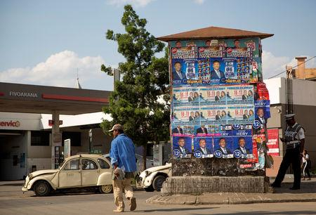 A man walks past the campaign posters of Madagascar Presidential candidate Hery Rajaonarimampianina during the presidential election along the street in downtown Antananarivo, Madagascar November 7, 2018. REUTERS/Malin Palm