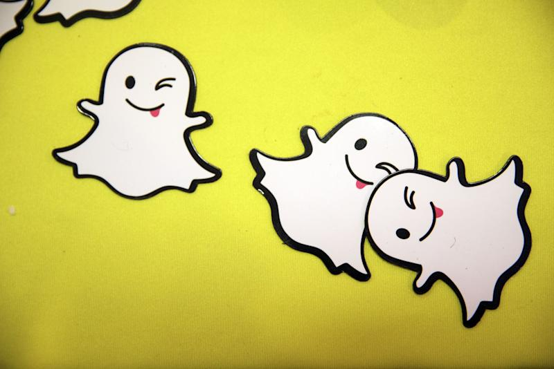 """(Bloomberg) -- It only took six months and a basket of disguises for Wall Street to love Snap Inc. again.Snap has seen a dramatic recovery over the past several months, with shares more than tripling off a record low in December to trade at their highest level in more than a year. While there have been a number of tailwinds supporting the social-media company, one key ingredient behind the turnaround is this: it now allows users to """"swap faces"""" with others in photographs, with """"lenses"""" or filters that can, for example, make men look like women or babies.Those who are unfamiliar with the latest viral sensations may view such a feature as an unusual foundation to build an investment on. But Wall Street sees the early-May launch of the filters as a key factor behind improving user trends at the Snapchat app, which is in turn leading to more optimistic projections for Snap's top- and bottom-lines.""""The timing of the filter appears to have driven a notable increase in engagement,"""" said Mark Kelley, an analyst at Nomura Instinet.Snap rose as much as 4.3% on Friday, extending a four-day winning streak, after Goldman upgraded the stock to buy from neutral. The new Android app, games and viral lenses drove record user adoption in May, reversing prior trends, analyst Heath Terry wrote in a research note.Wall Street's expectations have been getting rosier, with MoffettNathanson writing that Snap was """"on the verge of writing their own 'Cinderella Story'."""" Compared with six months ago, the consensus for Snap's adjusted full-year loss has improved by about 25% while revenue expectations are up 5.4% over that period.Bank of America on Thursday raised its revenue estimates on Snap for 2019 through 2021 and lifted its price target to $17 from $12. The firm expects user upside in the quarter. The comments came just two days after Credit Suisse lifted its own target for similar reasons. The shares are now trading at their highest level since March 2018, having more than tripled since D"""