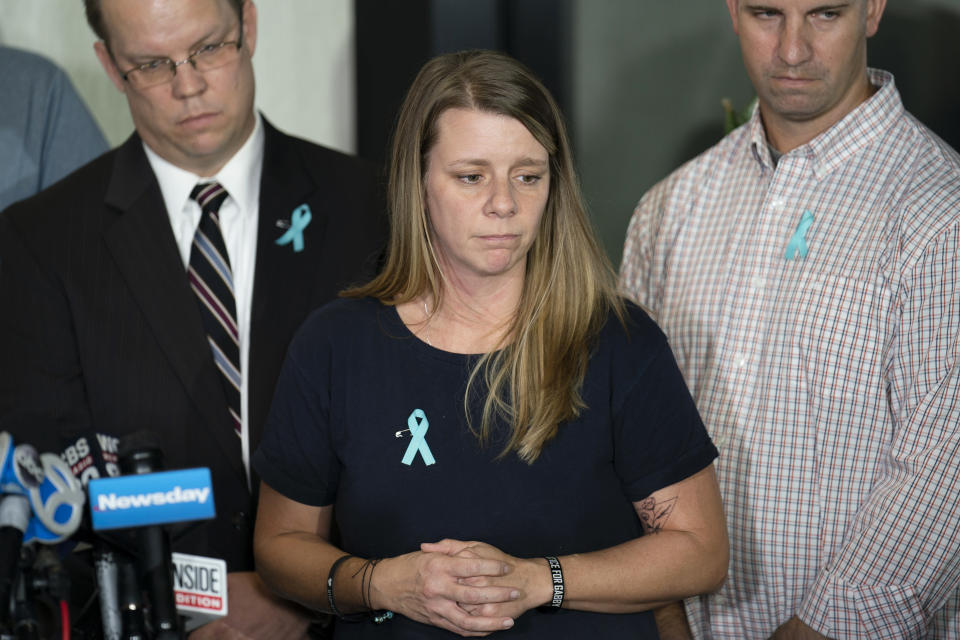 Nichole Schmidt, mother of Gabby Petito, whose death on a cross-country trip has sparked a manhunt for her boyfriend Brian Laundrie, pauses as she answer reporter's questions during a news conference, Tuesday, Sept. 28, 2021, in Bohemia, N.Y. (AP Photo/John Minchillo)